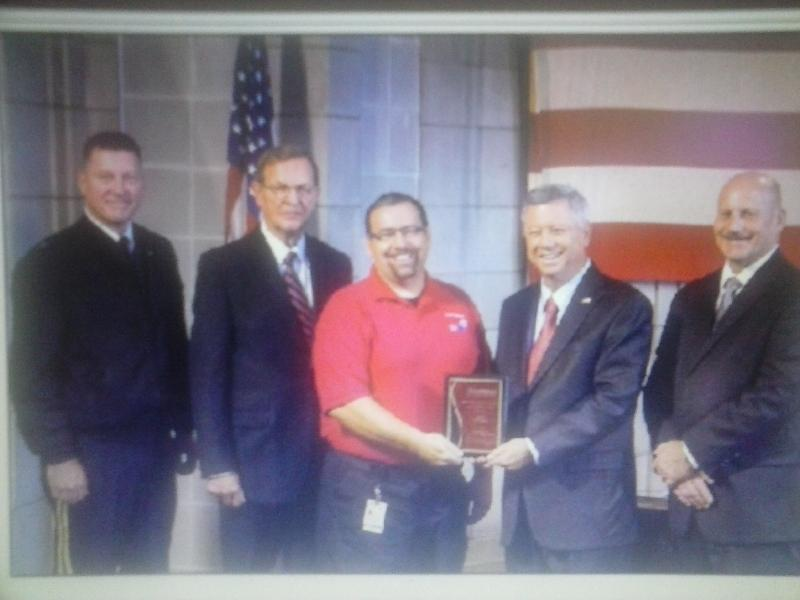 Coordinator Ron Pughes accepts Preparedness Award from Governor